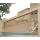 instalação de portão articulado com social embutido Instituto da Previdência