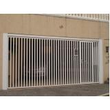 portão basculante com porta social preço Vila Morumbi